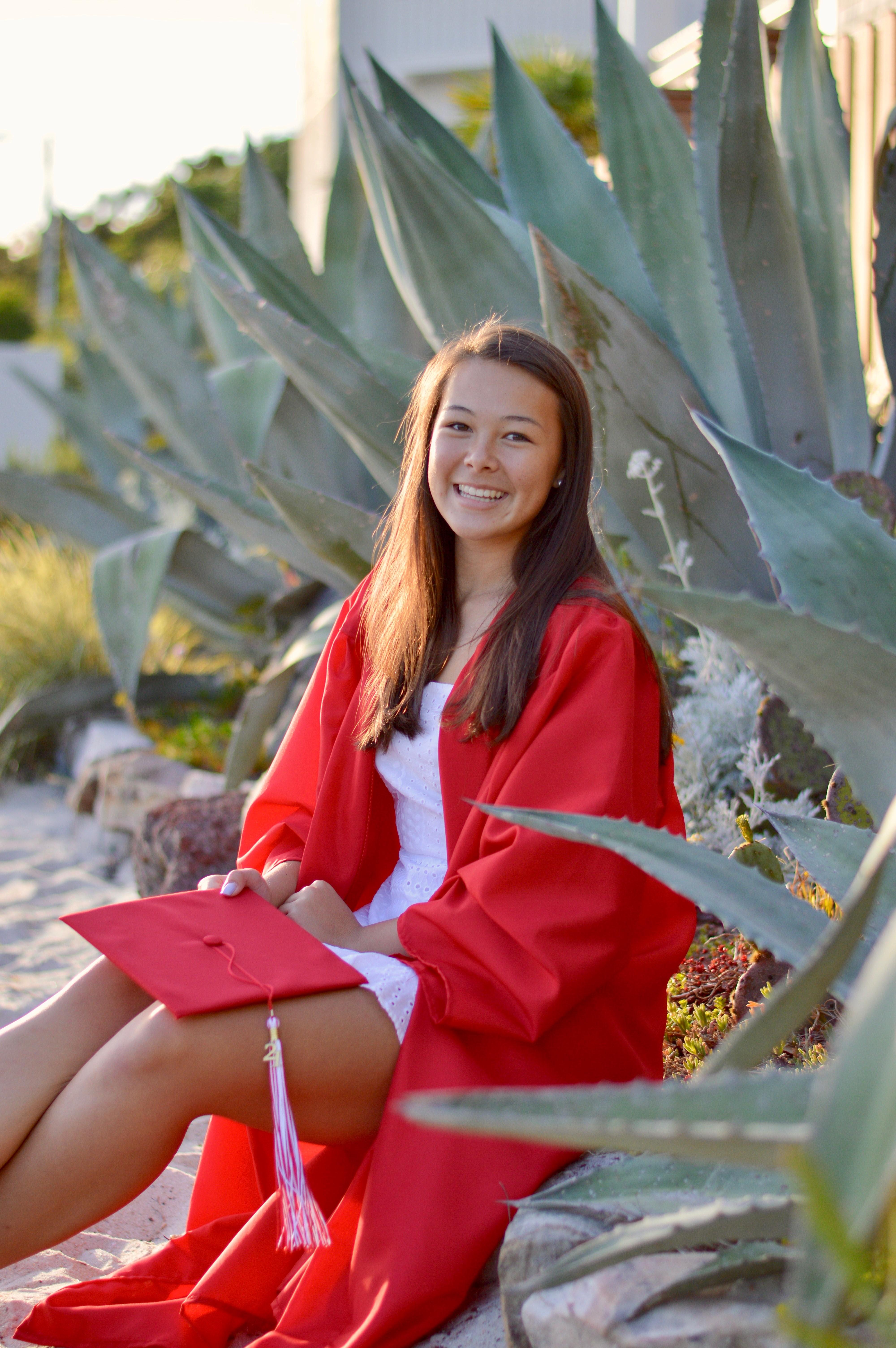 Union Academy graduate, Mya Manivanh, in red graduation gown.