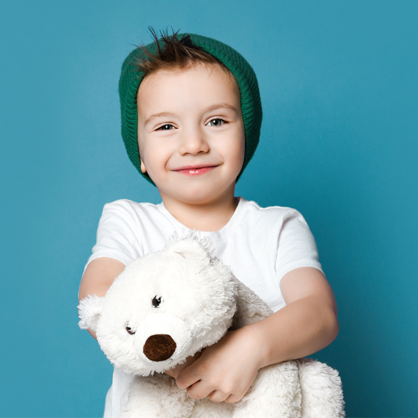 child holding a stuffed polar bear.